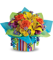 Teleflora's Rainbow Present from Victor Mathis Florist in Louisville, KY